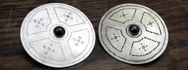 Pair of large saxon disc brooches